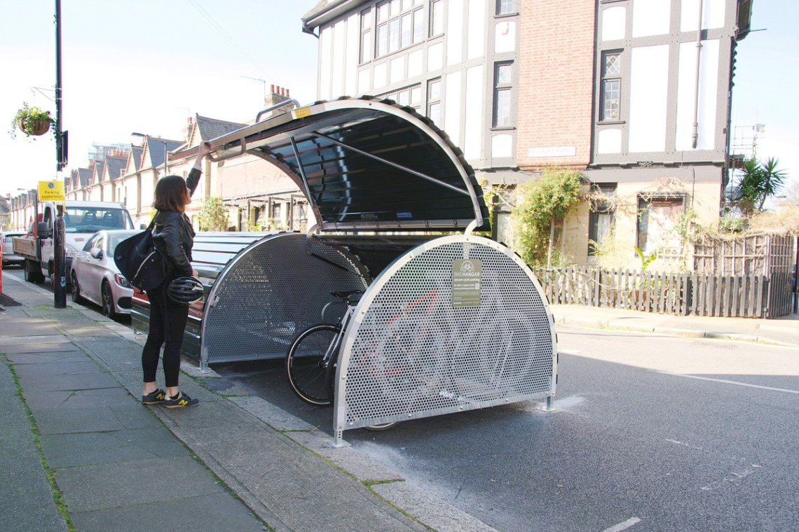 Woman using a cycle parking hanger London
