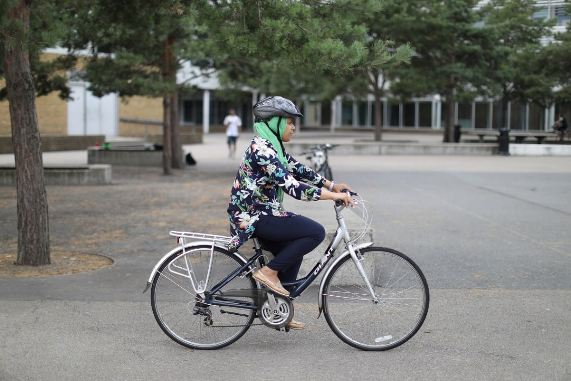 Person cycling on a path in a cycle skills session