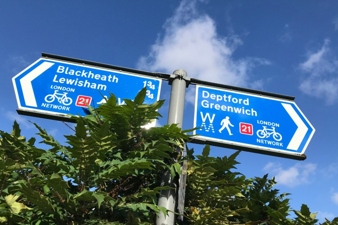 A signpost which points to the walking and cycling path to Deptford