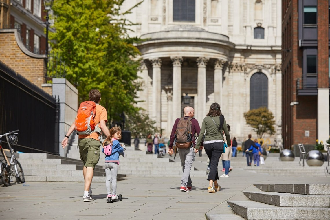 Small groups walking in front of St Paul's Cathedral