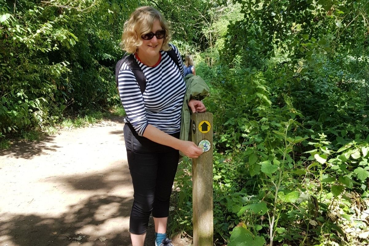 clare next to walking route post
