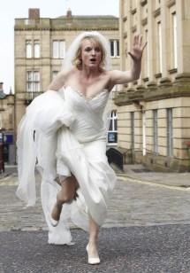 Running Bride in Wedding Dress