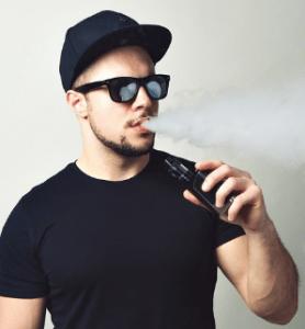man using vaporizer
