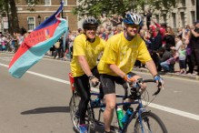 Cyclists riding a tandem on Whitehall.