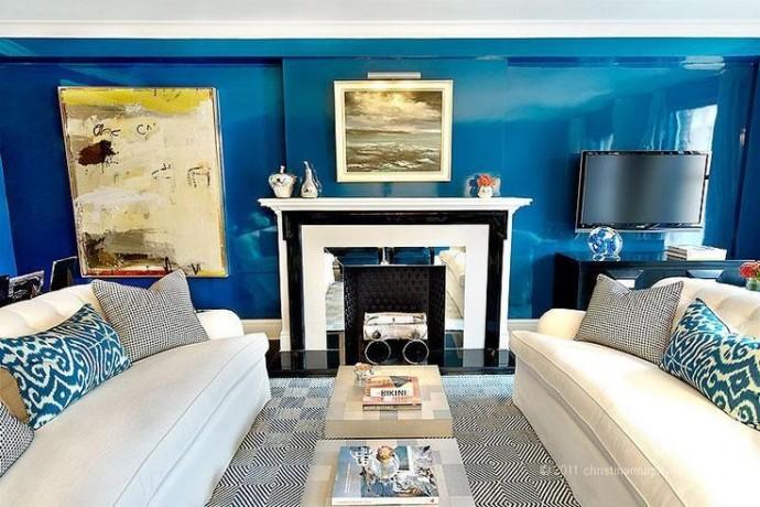 Rich Dark Gloss Blue Walls With Cream Sofa's