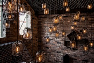 How To Enhance The Style Of Your Home - Industrial Room With Many Hanging Lights