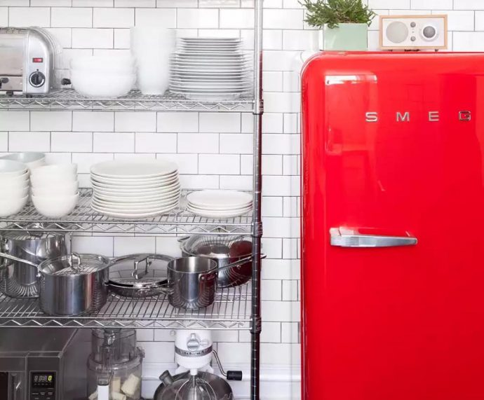 Common refrigerator problems that can be easily fixed - Red Smeg Fridge - Image By DesignMilk