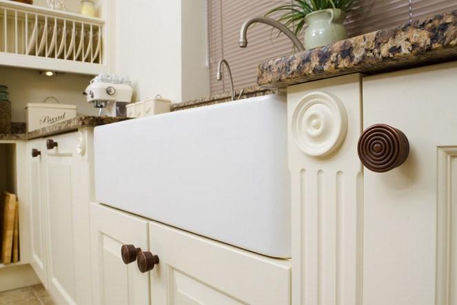 Cream farmhouse kitchen cupboards and butler sink.