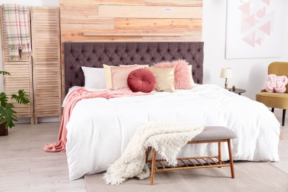 Comfy bedroom with large bed and pillows