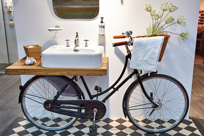 Retro bicycle attached to bathroom wash basin/sink