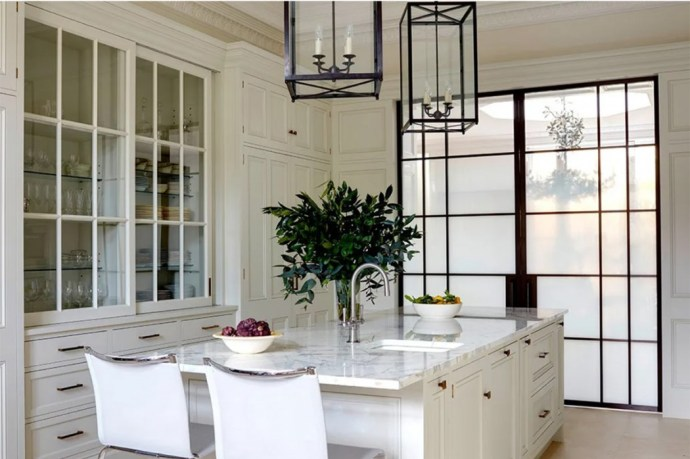 Stylish White Kitchen With Island And Double Glass Doors