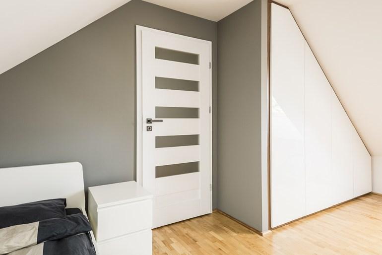 Attic bedroom with built in wardrop