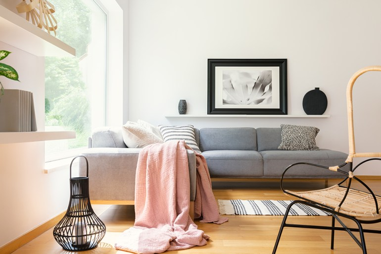Grey sofa with pink throw