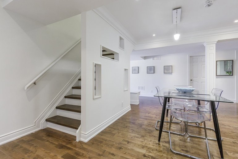White painted basement dining room