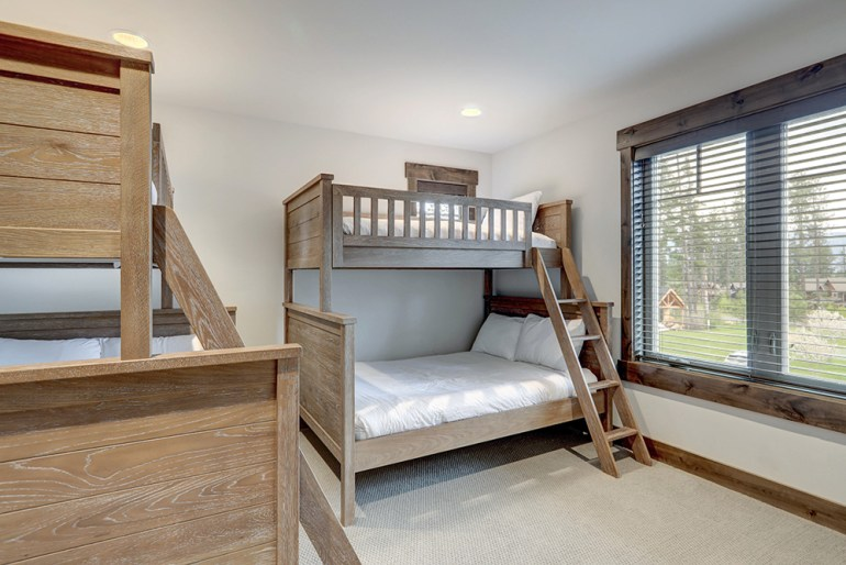 Four beds in one room. Wooden double and single bunk beds