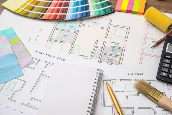 Colour samples with house plan, calculator and pen