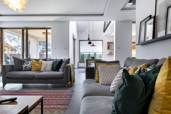 Modern openplan livingroom with two grey sofas