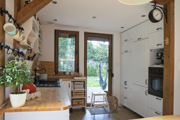 White and Country kitchen with wooden worktops and built in kitchen storage.