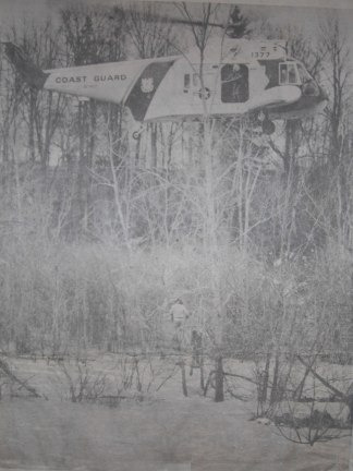 U.S. Coast Guard helicopters were used in two separate incidents over the weekend to save a total of 12 persons in the London area. In the Sunday rescue, one man climbs into the basket lowered by the helicopter while another clings to a tree in the middle of the Thames River below Fanshawe Dam. Eight firefighters also had to be rescued by the chopper. By Sam McLeod of The Free Press