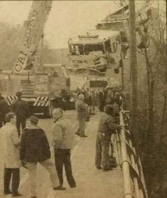 A heavy crane is used to lift the wrecked pumper from the river bank on to the bridge. (Ed Heale/The London Free Press)