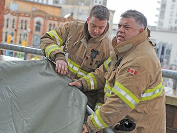 London firefighters set up camp on top of Covent Garden Market.