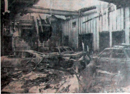 Only the walls, scattered debris and the hulks of a few cars remain of the showroom following a fire late Wednesday at Competition Motors (London), Ltd., 1206 Oxford St. E. Damage was estimated at $250,000. The fire also destroyed cars parked near the building. Armored personnel carriers from CFB London were dispatched to assist firemen. (Sam McLeod - The London Free Press)