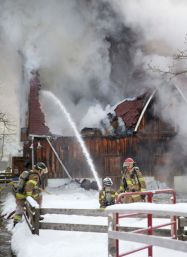 Firefighters battle a fire in a livestock barn at Storybook Gardens in Springbank Park in London, Ontario on Tuesday February 3, 2015. Three donkeys, three sheep, four rabbits and two goats housed in the barn, built in 1958, were evacuated safely, and city officials are looking for temporary homes. An investigation into the cause of the fire is ongoing. CRAIG GLOVER/The London Free Press/QMI Agency