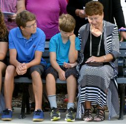 Deanna Hart sits with her grandsons Joshua Hart, 13, left, and Noah Mann, 10, during a ceremony to remember firefighters who died in the line of duty at London Fire Station No.1 on Sunday September 11, 2016. Hart's husband Captain Vince Hart, who died of lung cancer in 2014 due to years of fighting fires, had his name added to the London Professional Firefighters Memorial Monument, which sits in front of the station. Mrs Hart also received the Pierce Medal recognizing Captain Hart's service. The ceremony is held annually on September 11 to remember the firefighters who died in the World Trade Tower attacks on September 11, 2001. MORRIS LAMONT/THE LONDON FREE PRESS /POSTMEDIA NETWORK