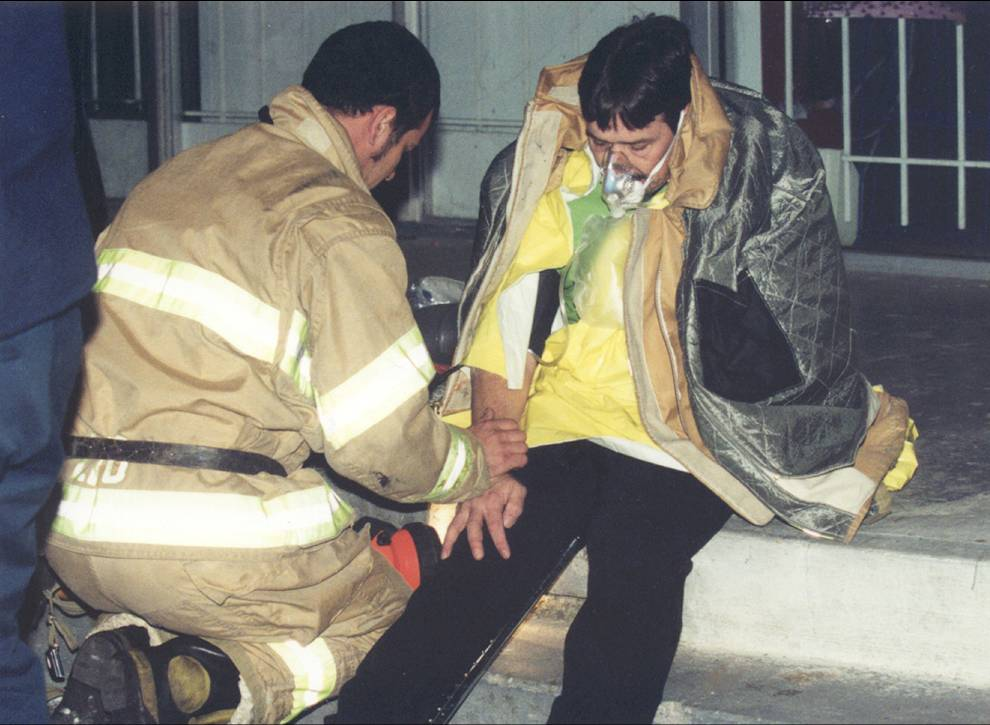 Fire fighter P. Olivia tending a patient.