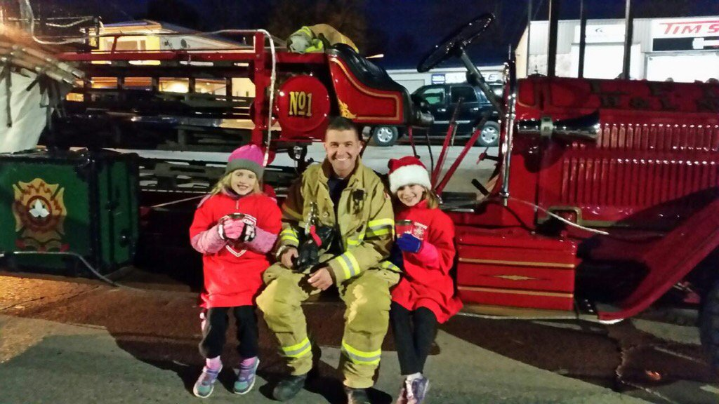 Firefighter sitting with daughters