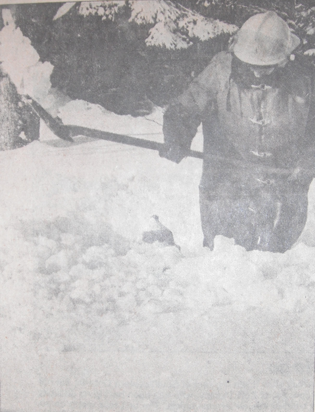 Firefighter Jim Myatt digging out the snow around a fire hydrant