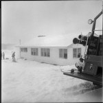Thames Valley Club House covered in snow with firetruck in the fore ground