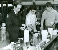 Glen Pearson, executive director of The London Food Bank, board chairman Gord Harrison and volunteer Mike Downing load up their hotdogs during a barbecue marking the successful conclusion of food drive. (April 2, 1988)