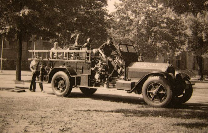 1955 London Fire truck and men doing training