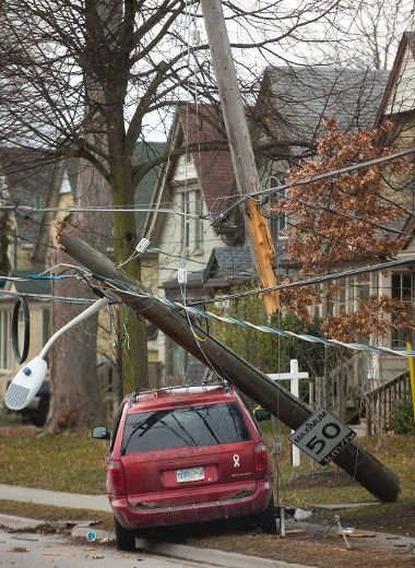 A van struck a utility pole on Oxford Street Tuesday afternoon. (MIKE HENSEN, The London Free Press)