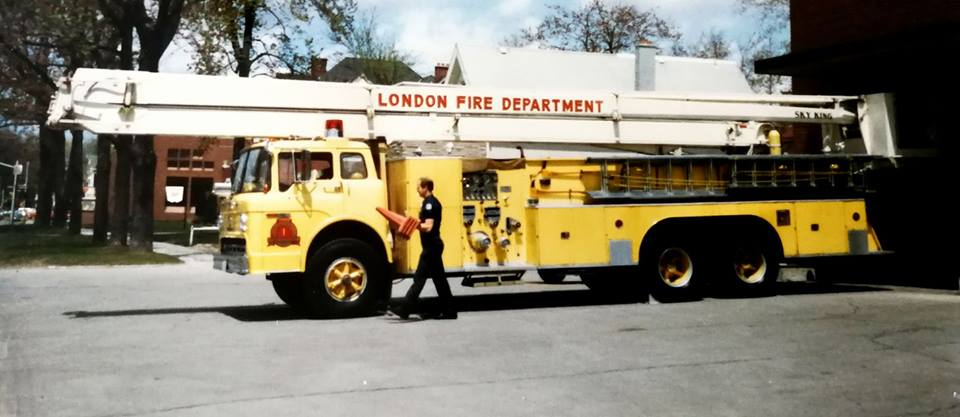 Firefighter walking beside truck one