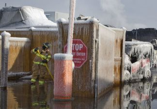Firefighter draining a parking lot from water run off