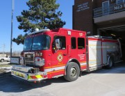 Fire engine number three parked in front of Station 3