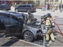 Firefighters were called to dowse a burning Ford Freestyle parked in front of Fireroasted Coffee Company on Dundas Street in London, Ont. on Tuesday May 8, 2018. The occupants of the vehicle were shopping in the area. When they left a store they found their vehicle ablaze. No on was injured in the incident. The cause of the fire is unknown.Derek Ruttan/The London Free Press/Postmedia Network