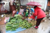 Selling leaves to wrap sticky rice and other treats.