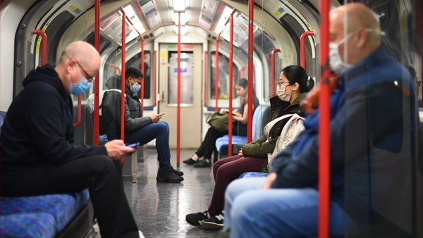 Central Line passengers using face masks during travel