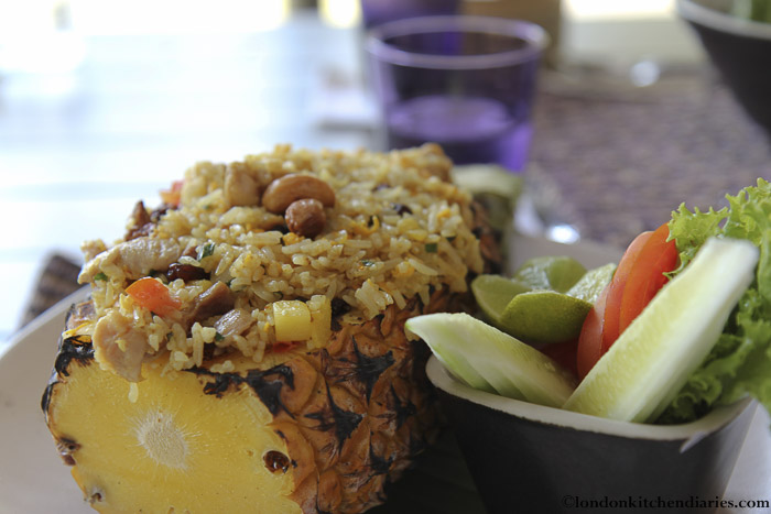 Fried pineapple rice served in a pineapple shell at Sala