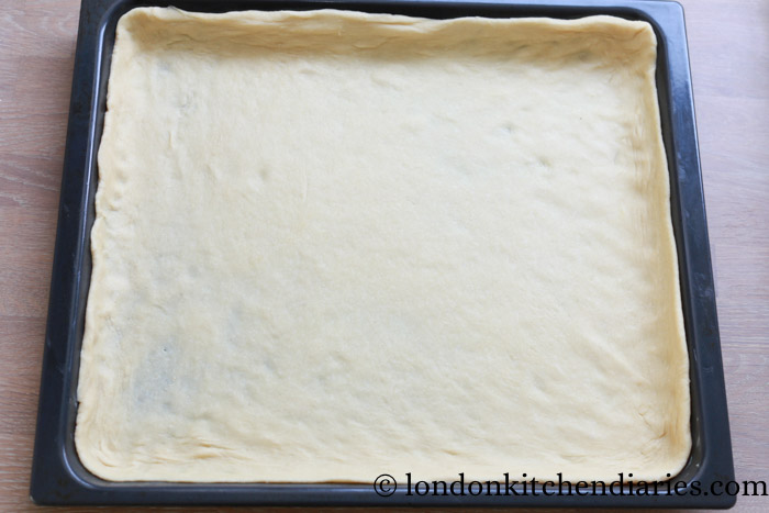 Yeast dough on baking tray