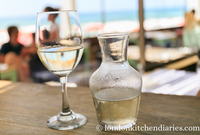 Carafe of cold white wine at Manta Ray Tel Aviv