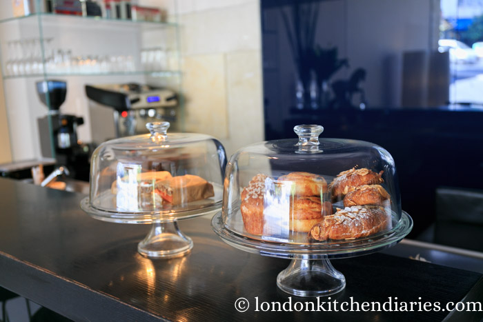 Glass pastry stands at Espresso Bar Mamilla Hotel