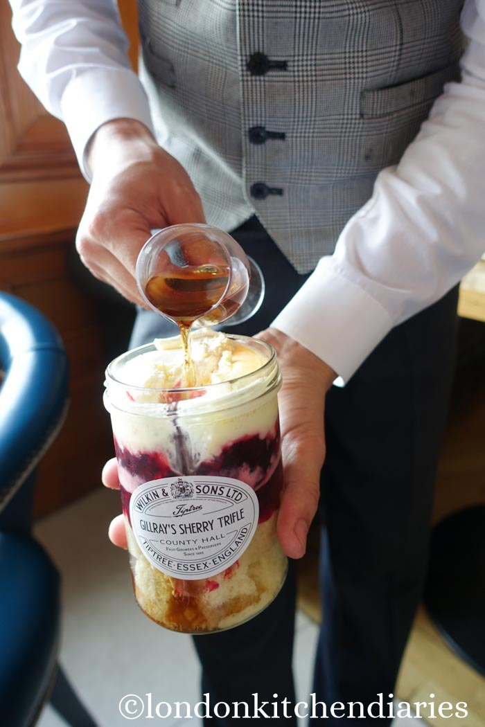 Adding sherry to traditional trifle at Gillray's Restaurant & Bar London