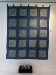 Silk wall hanging and teaset