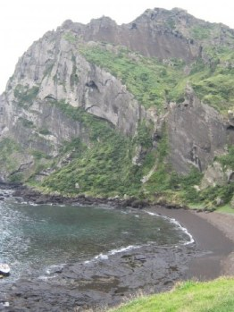 Black sand beach where women dive, below the famous Seongsan Sunrise Peak, where people go on New Year's Day. Today the Chinese tourists beat me to the peak.
