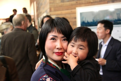 Judy Jung with her young helper in charge of Front of House