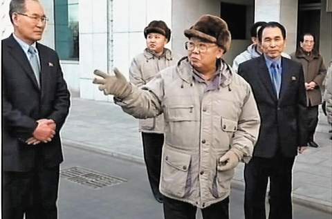 Kim Jong-il and Kim Jong-un in matching anoraks